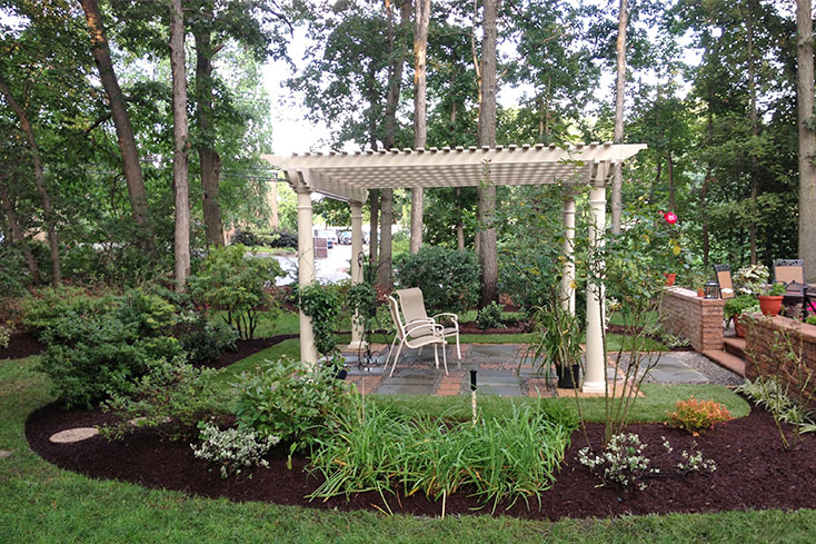 garden pergola with sitting area
