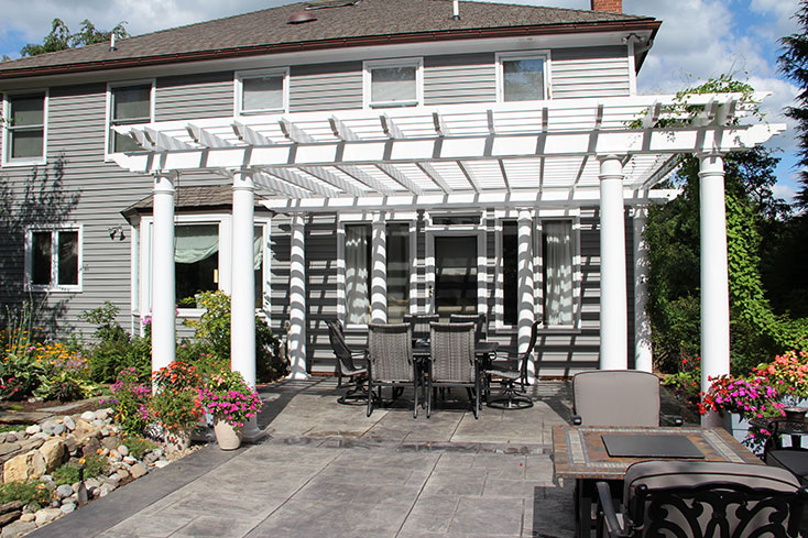 pergola over a patio dining area