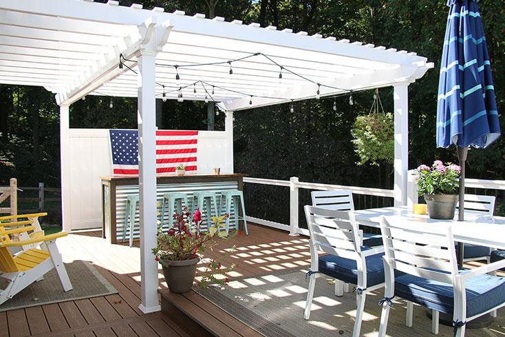 backyard space with vinyl pergola